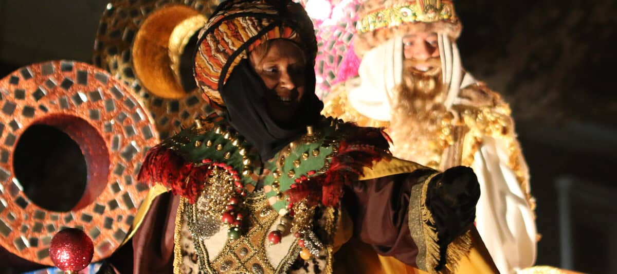 Melchor, one of the three wise men, on a float in a 3 King's Day procession in Spain
