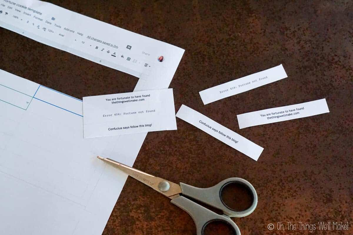 Cutting out printed fortunes for fortune cookies.
