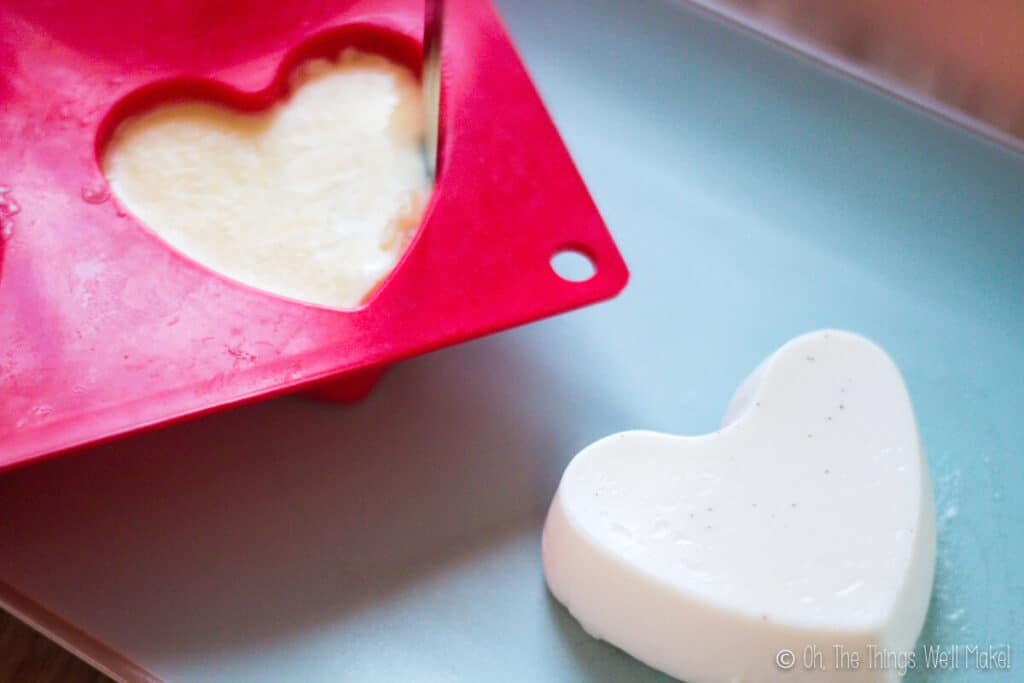 Removing a heart-shaped panna cotta from heart-shaped silicone muffin tins