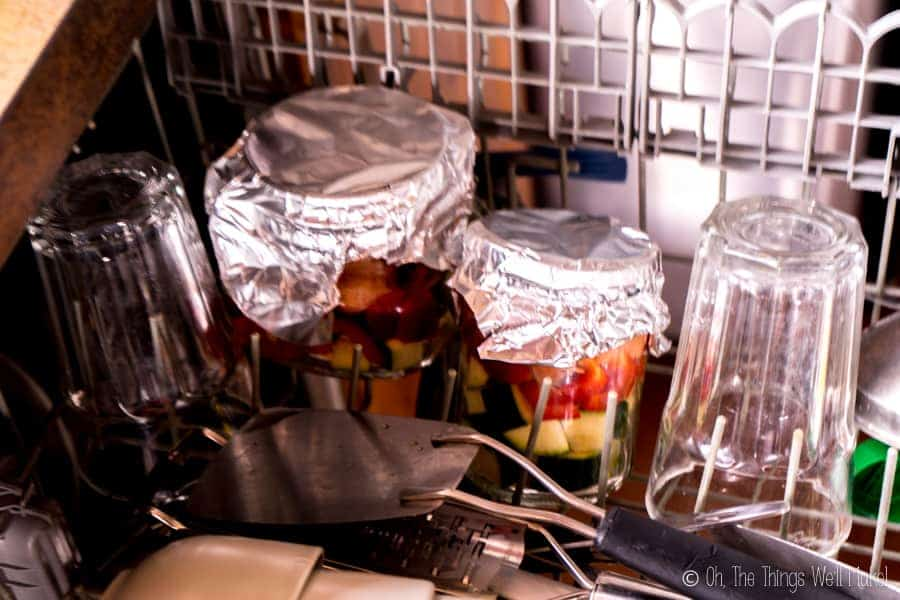 Salmon in jars in the dishwasher, ready for cooking there.