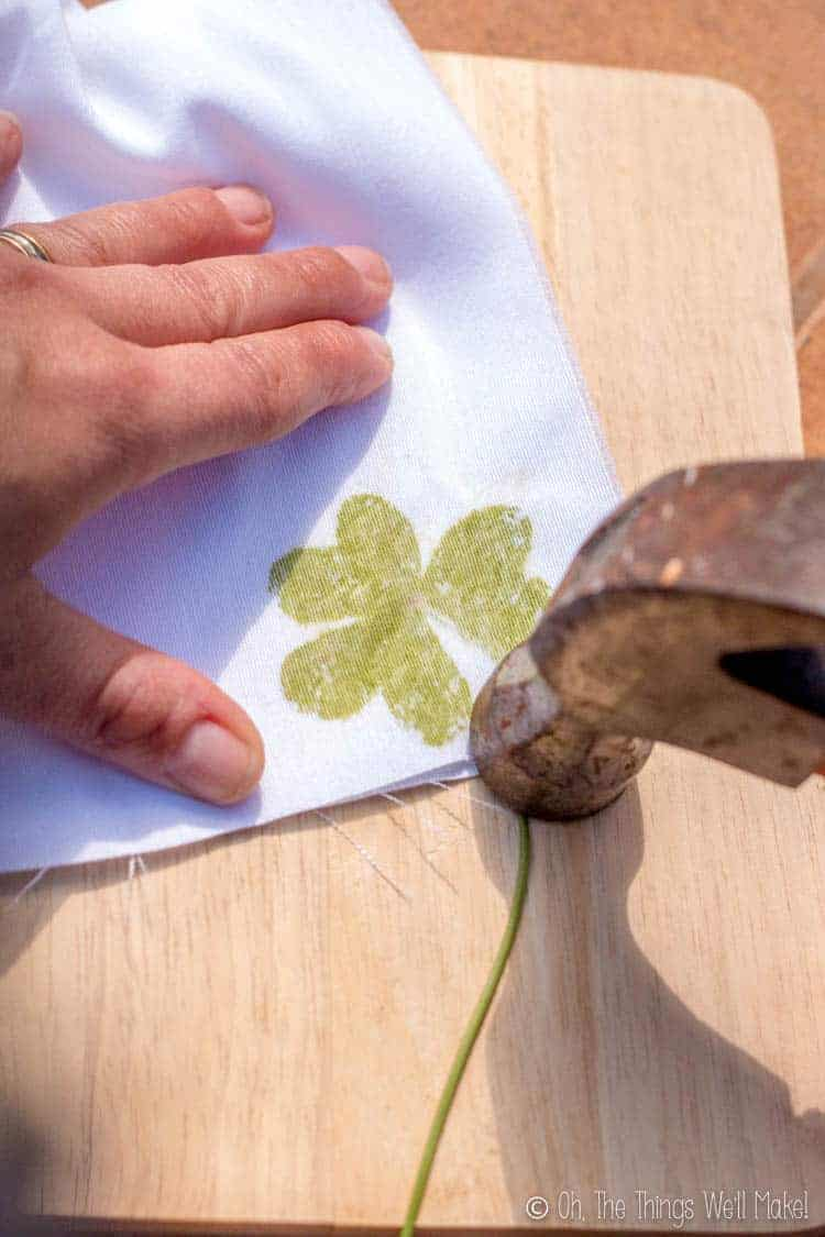 Tapping over the cloth covered clover with a hammer. You can see the dye seeping through.