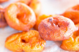 recently fried pumpkin fritters on a paper towel to drain the excess oil
