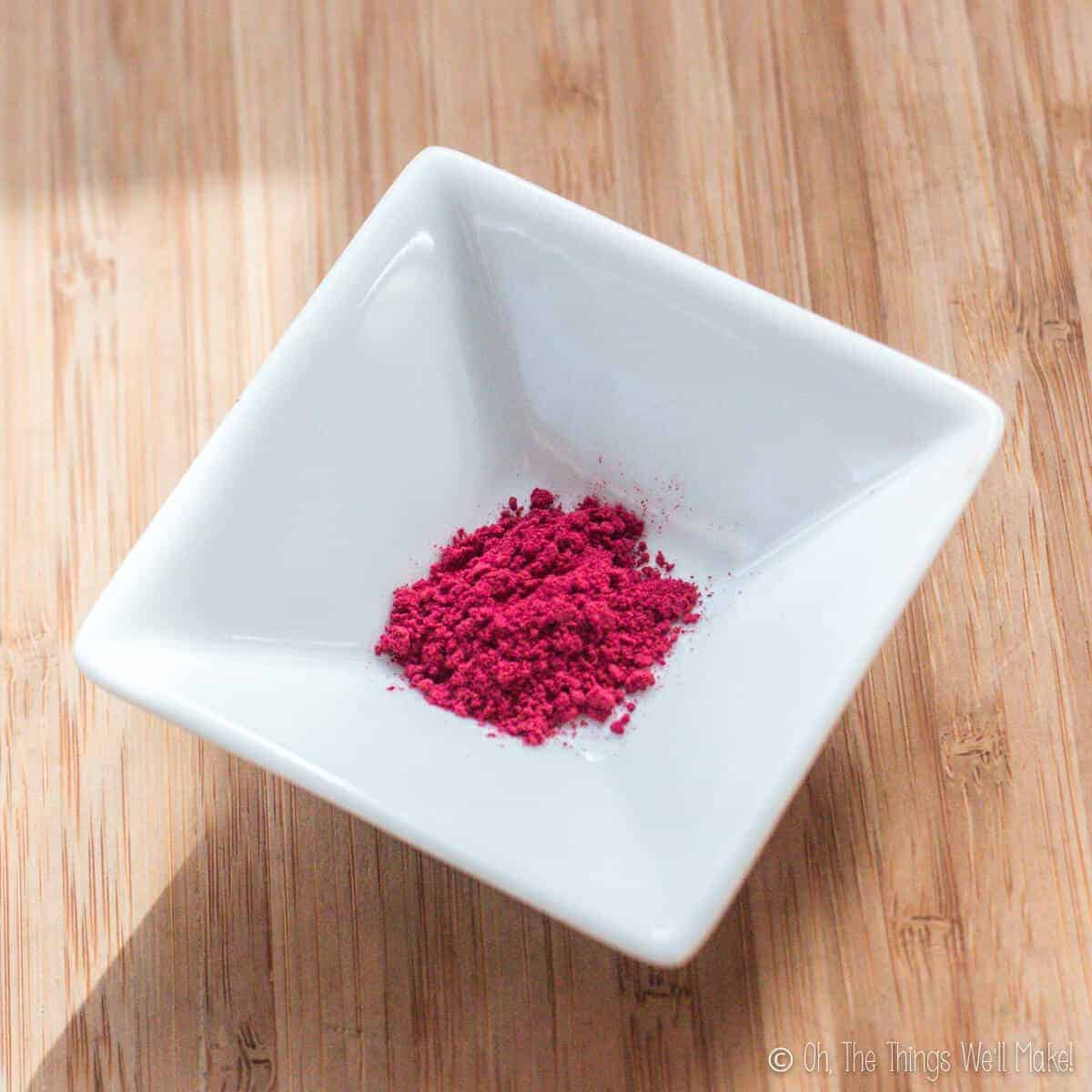 overhead view of a small bowl with beetroot powder