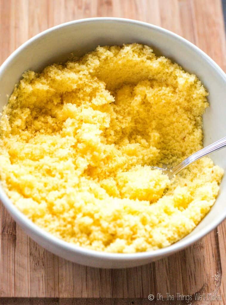 A bowl of yellow sugar crystals