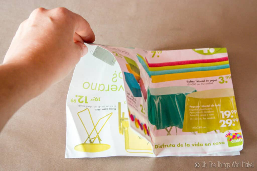 Opening up one side of the folded piece of paper