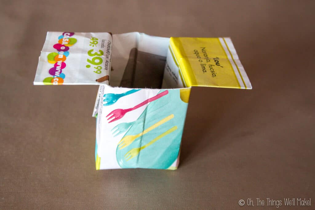 An open origami newspaper pot.