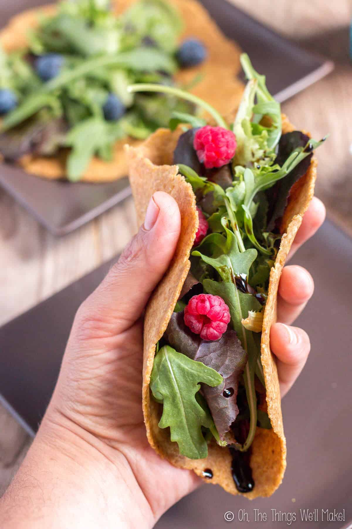 Lettuce and raspberries wrapped in a flaxseed tortilla