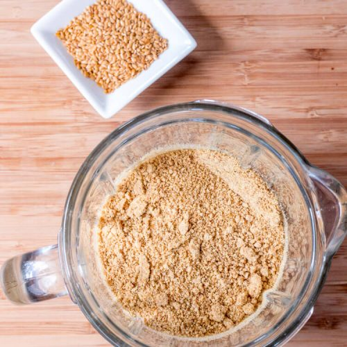 flax seeds and ground flaxseeds in a blender