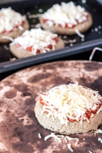 This paleo pizza crust recipe is quick and easy and absolutely delicious. Even my picky husband and toddler love it when I make pizza with it.