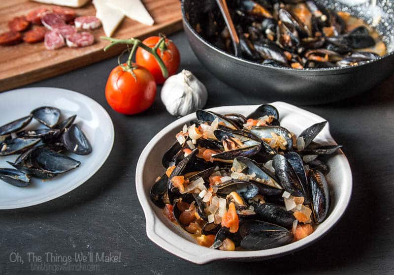 These easy steamed mussels in tomato sauce are a quickly made and sure to impress. Even my toddler loves scooping up the sauce with the empty shells.