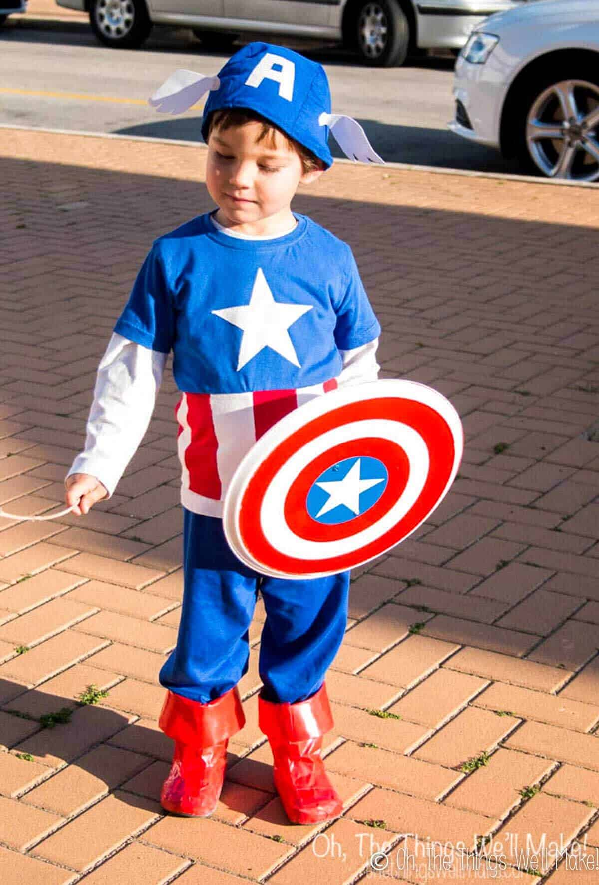 Boy outside dressed in homemade Captain America costume