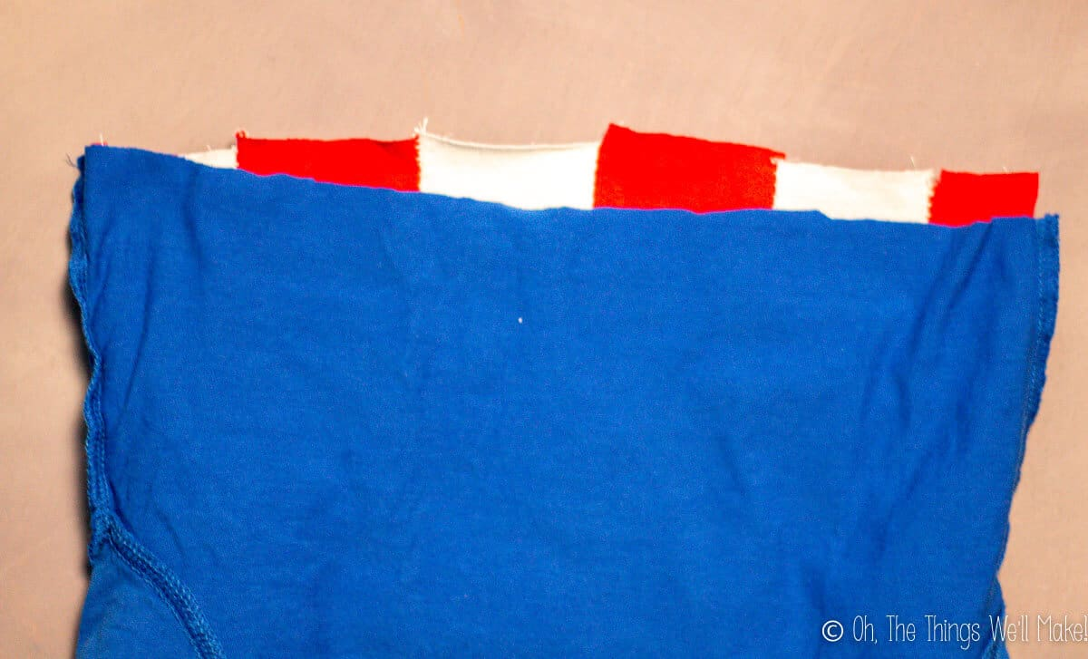 lining up the stripes and blue t-shirt to finish sewing Captain America's shirt