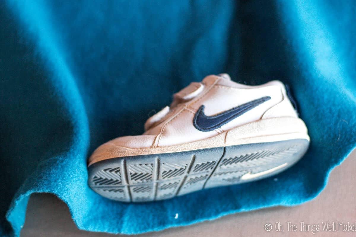wrapping polar fleece around a child's athletic shoe.
