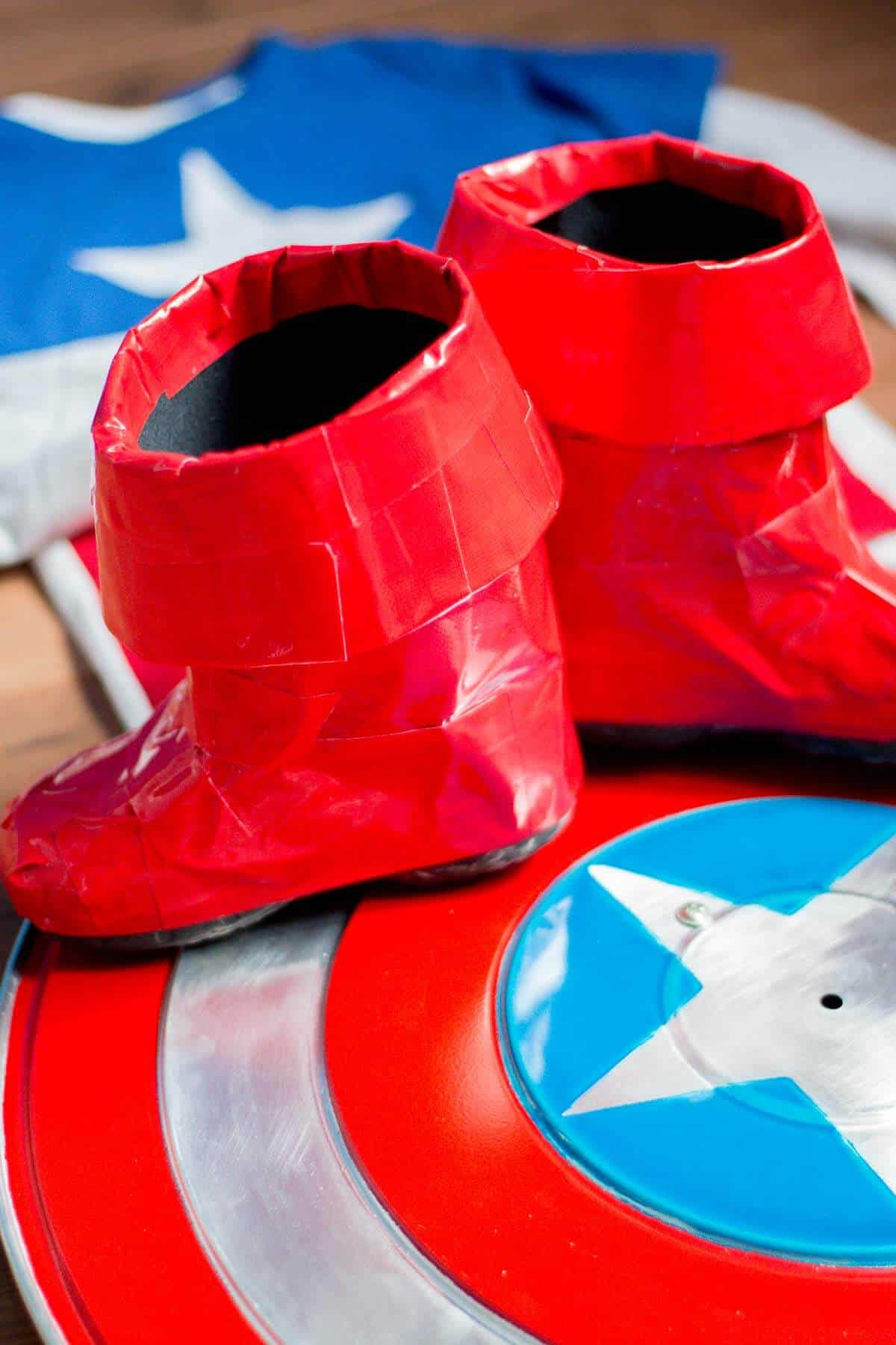 Homemade Captain America Boots made from duct tape on a homemade Captain America shield