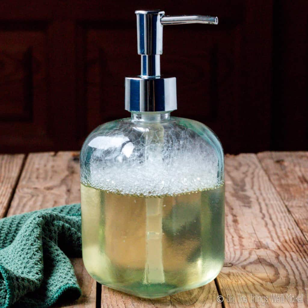 a bottle of clear liquid soap made with coconut oil