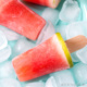 Closeup of a homemade watermelon gelatin pop on a plate with ice