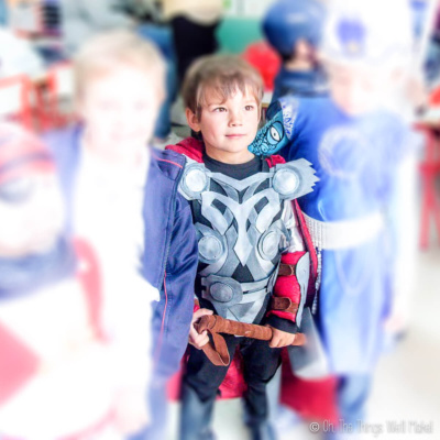 Closeup of a boy dressed up as Thor at a costume party. (The other kids are blurred out.)
