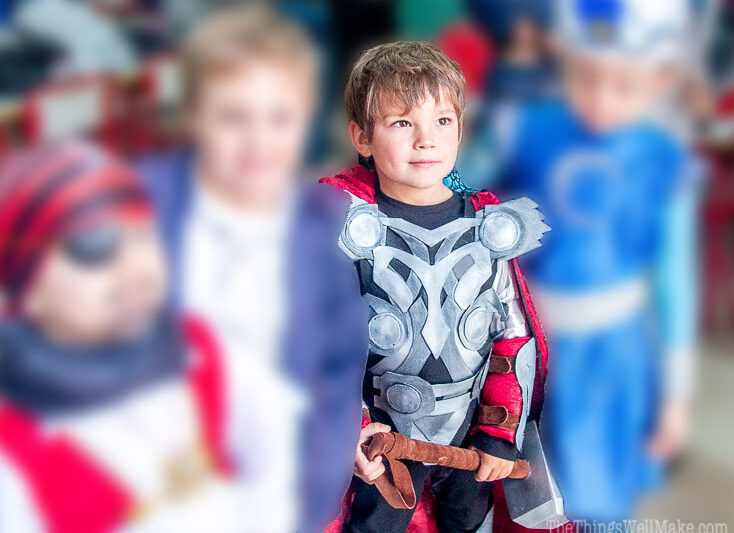 photo of kids dressed up as superheroes focusing on boy dressed in a homemade Thor costume