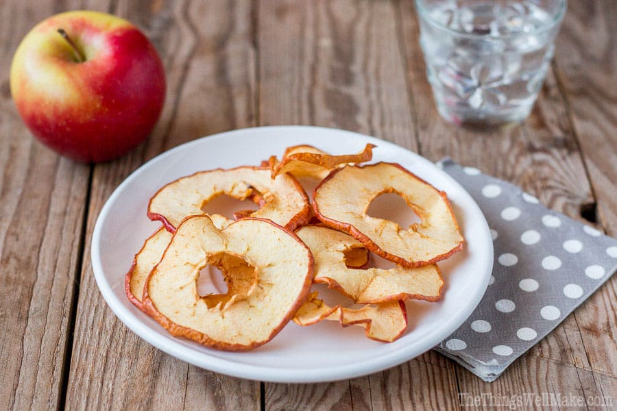 Dried apple chips on a plate.