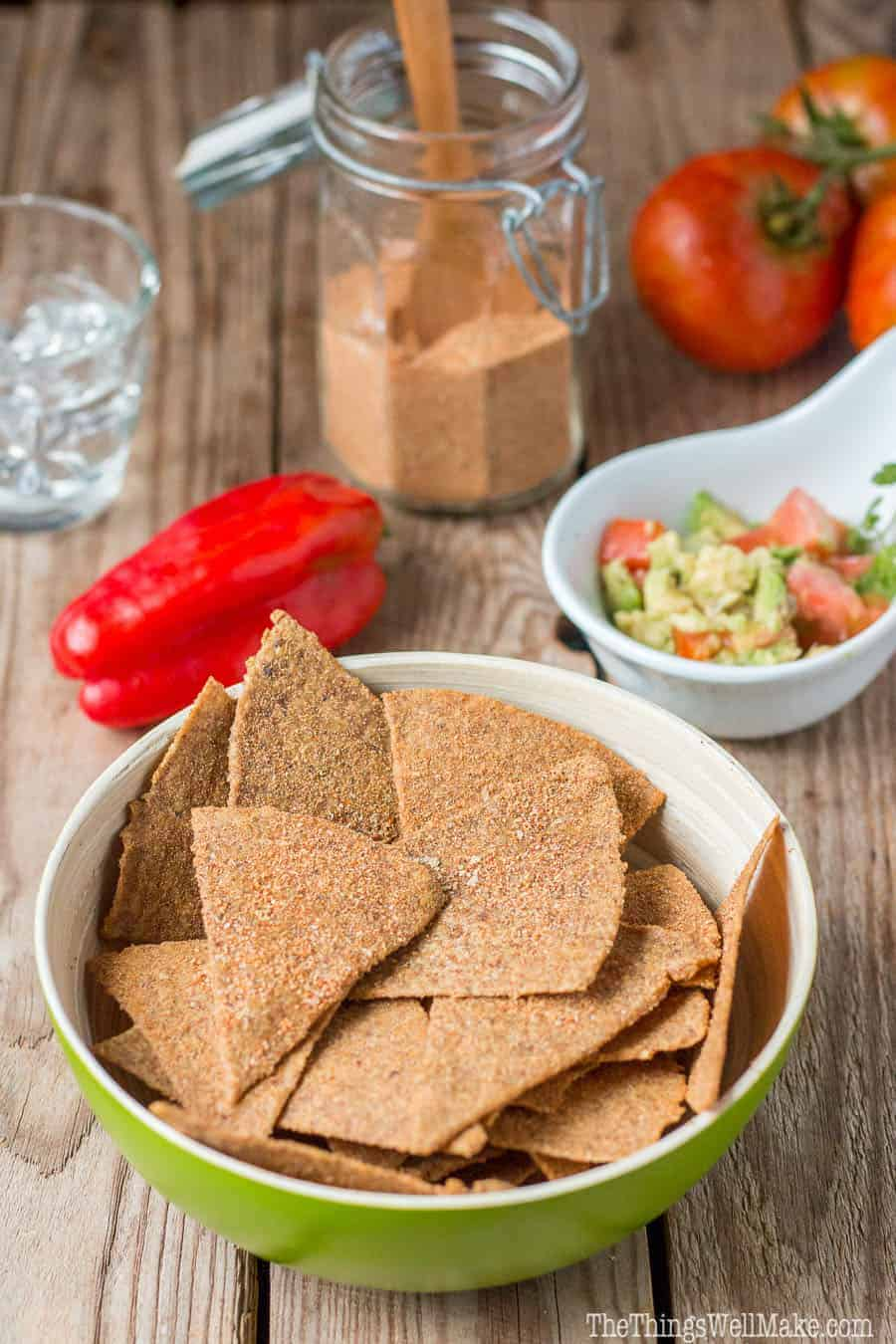 A bowl of paleo Dorito-like chips made of flaxseeds