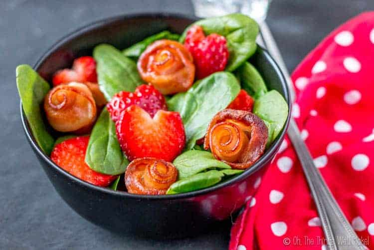 A Valentine's Day salad made with bacon roses and strawberry hearts.