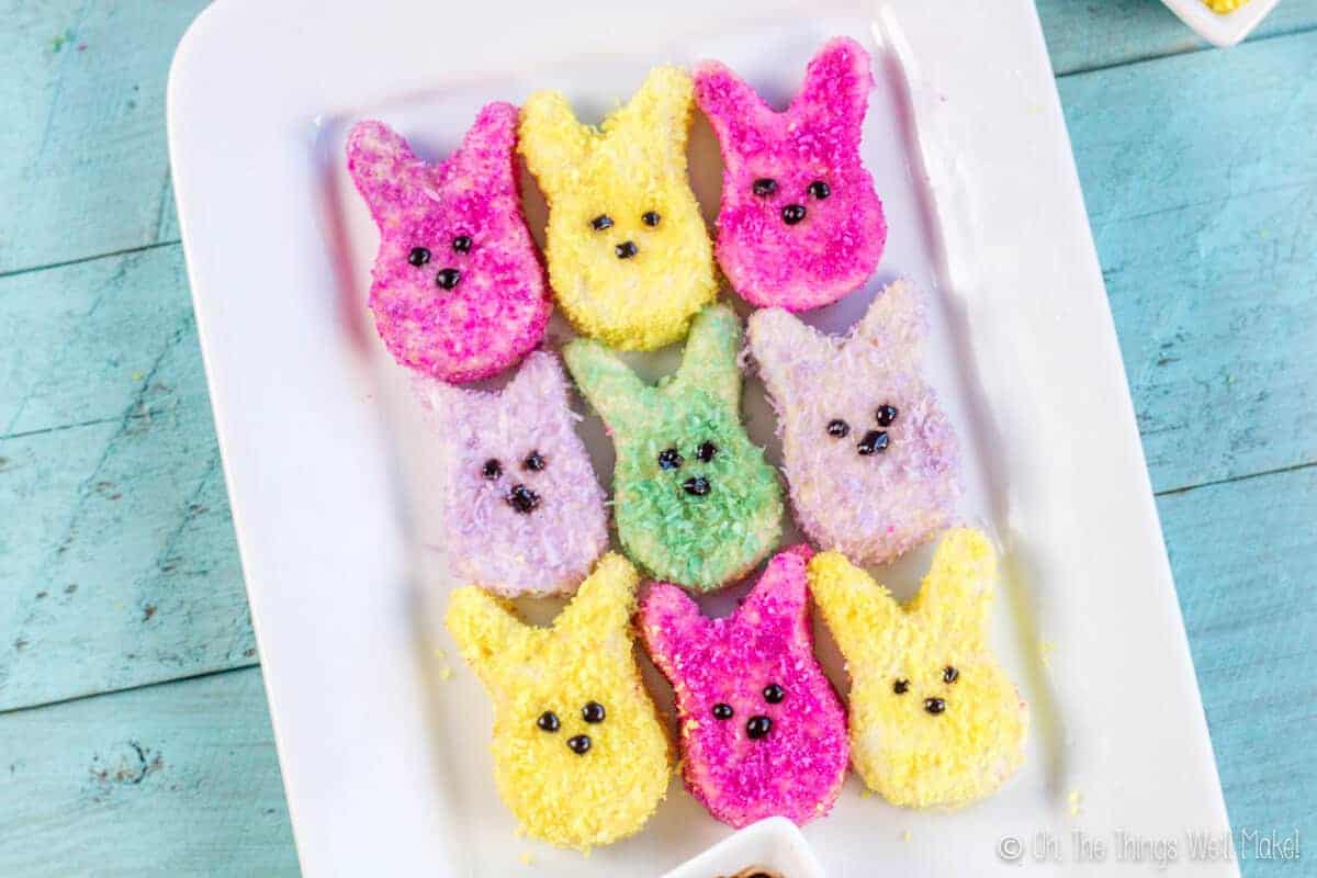 homemade bunny shaped marshmallow peeps covered with bright coconut sprinkles made with natural colors.