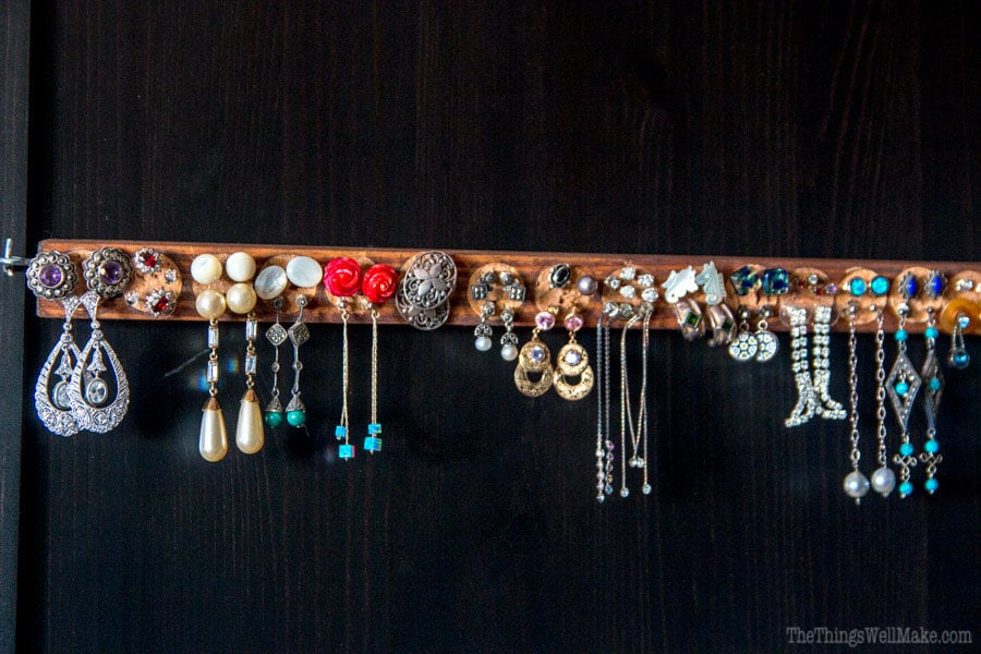 Using recycled materials like scraps of wood and wine corks, you can make a handy DIY earring holder for studs and post earrings that is also a beautiful and practical display organizer.