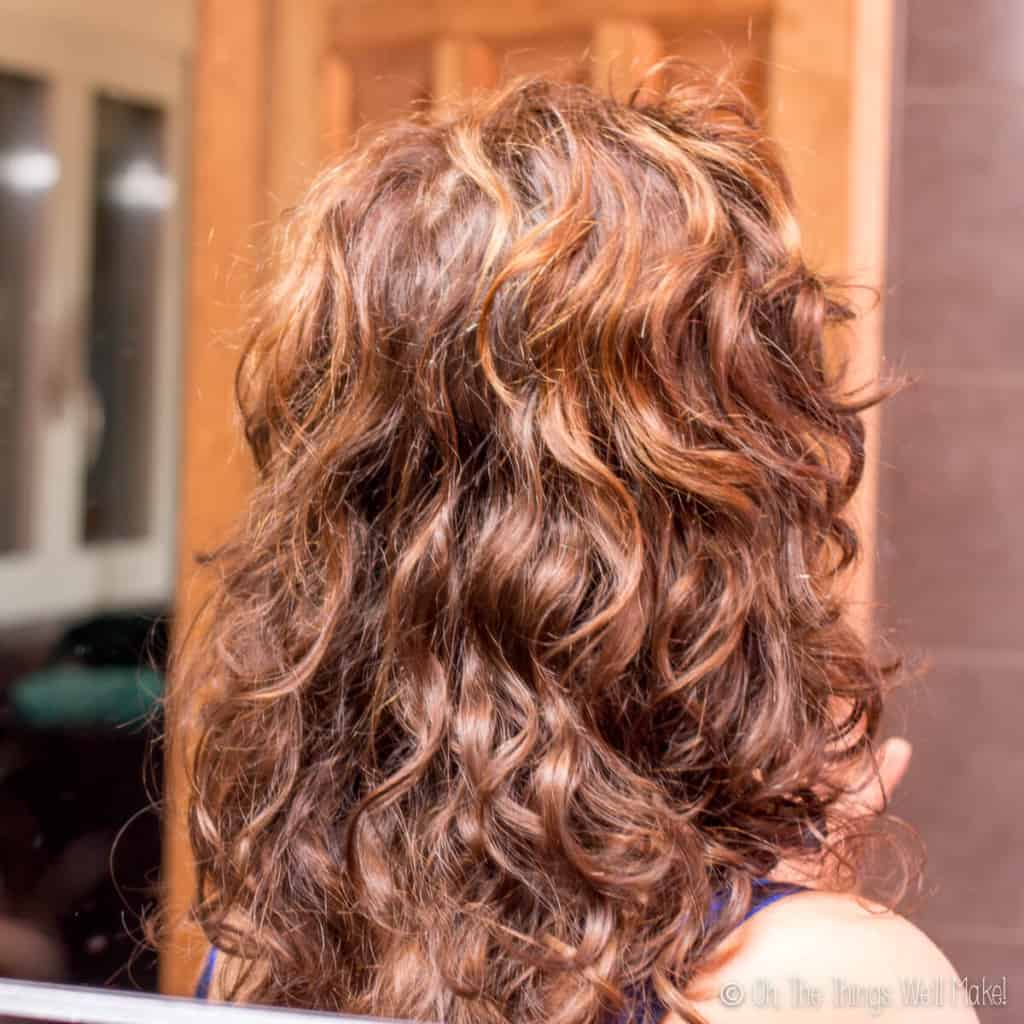 A closeup of wavy hair from the back