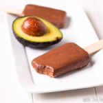 Smooth and creamy, these paleo chocolate avocado pudding pops seem indulgent, but are a fun, no guilt treat that is perfect for summer.