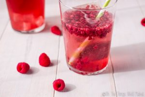 Ditch the unhealthy sodas, and switch to a much healthier paleo red pop, or red soda, which can be made two ways using a combination of herbs, fruits, and soda water.