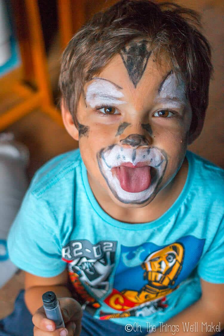 boy wearing homemade costume makeup painted to look like a tiger