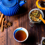 chai tea loose leaf tea with spices, brewed glass, and blue kettle