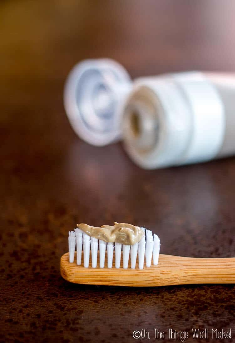 Homemade natural toothpaste (without cacao) shown on bamboo toothbrush.