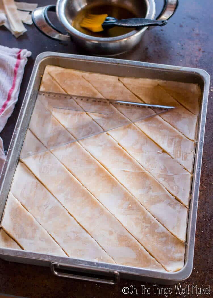 Cutting the baklava into a diamond pattern.