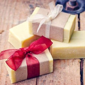 homemade bars of soap wrapped in brown paper and ribbons