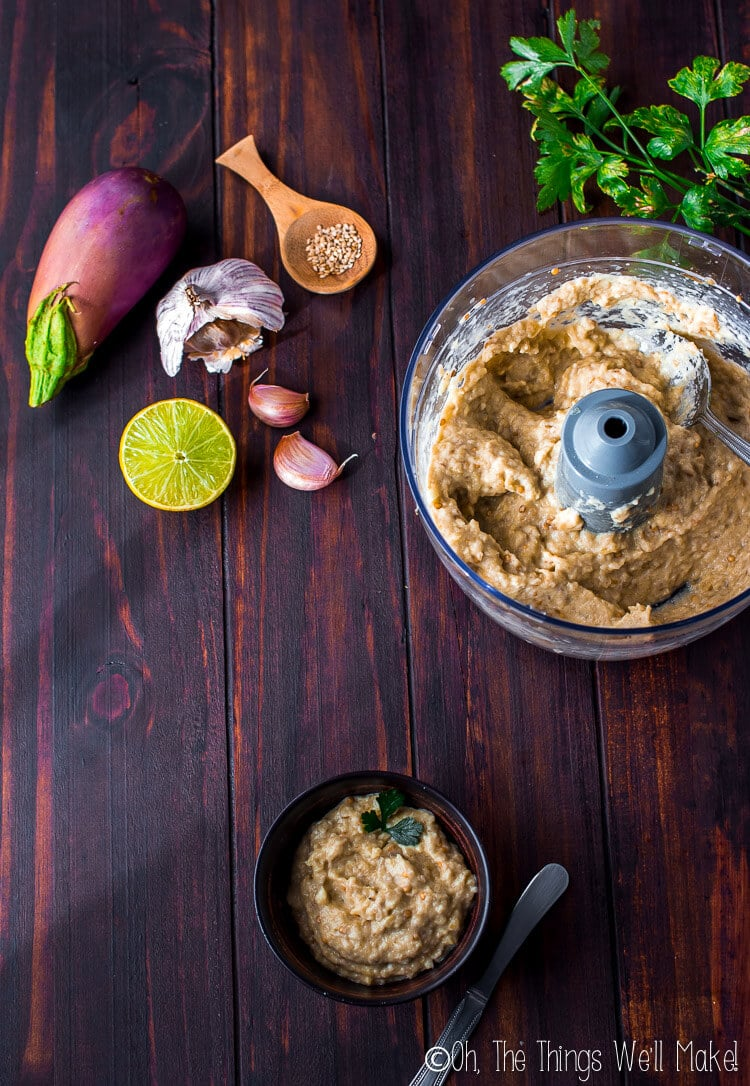 bowl of baba ganoush and food processor bowl as seen from above