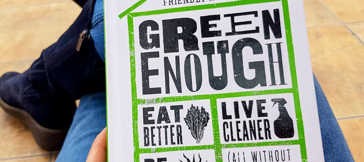 """Photo of somebody holding the book """"Green Enough"""" by Leah Segedie."""