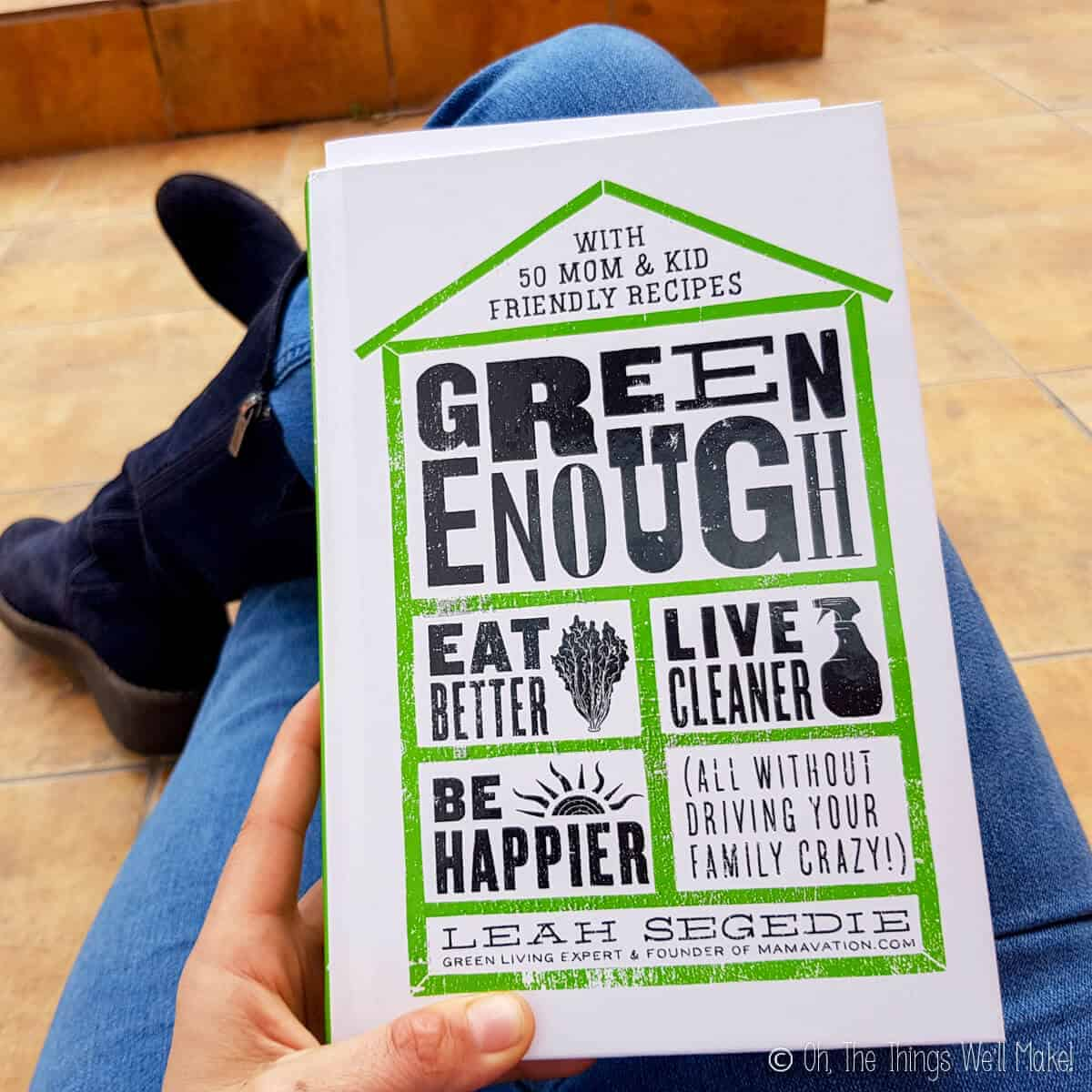 "Photo of somebody holding the book ""Green Enough"" by Leah Segedie."