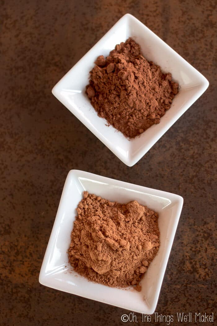 Dutch processed cocoa powder in a small bowl above another small bowl of natural cacao