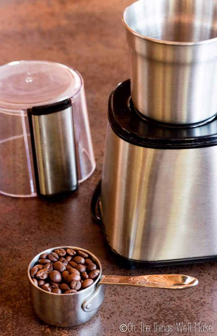 grinding the coffee beans in a coffee grinder