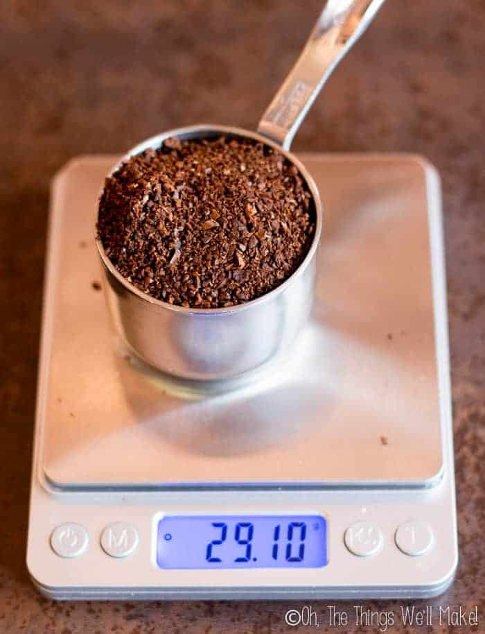 A third of a cup of ground coffee beans on a scale showing 29.1g