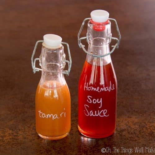 Homemade soy sauce next to homemade tamari