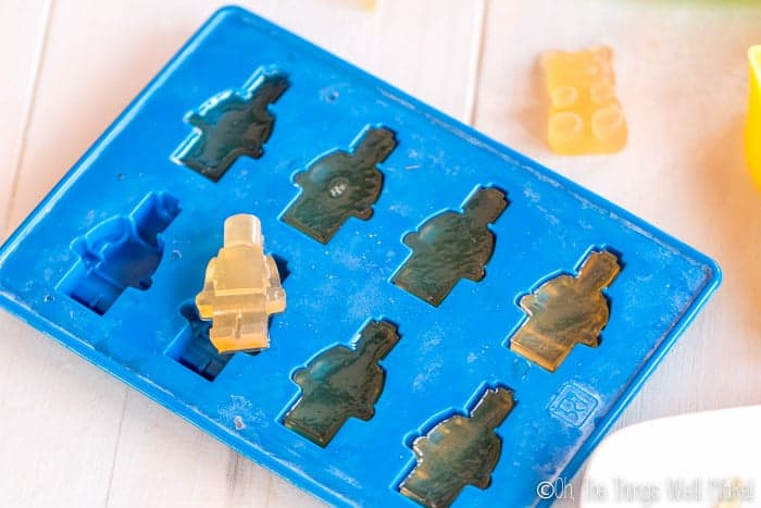 Lego figure gummy treats over a lego figure mold.