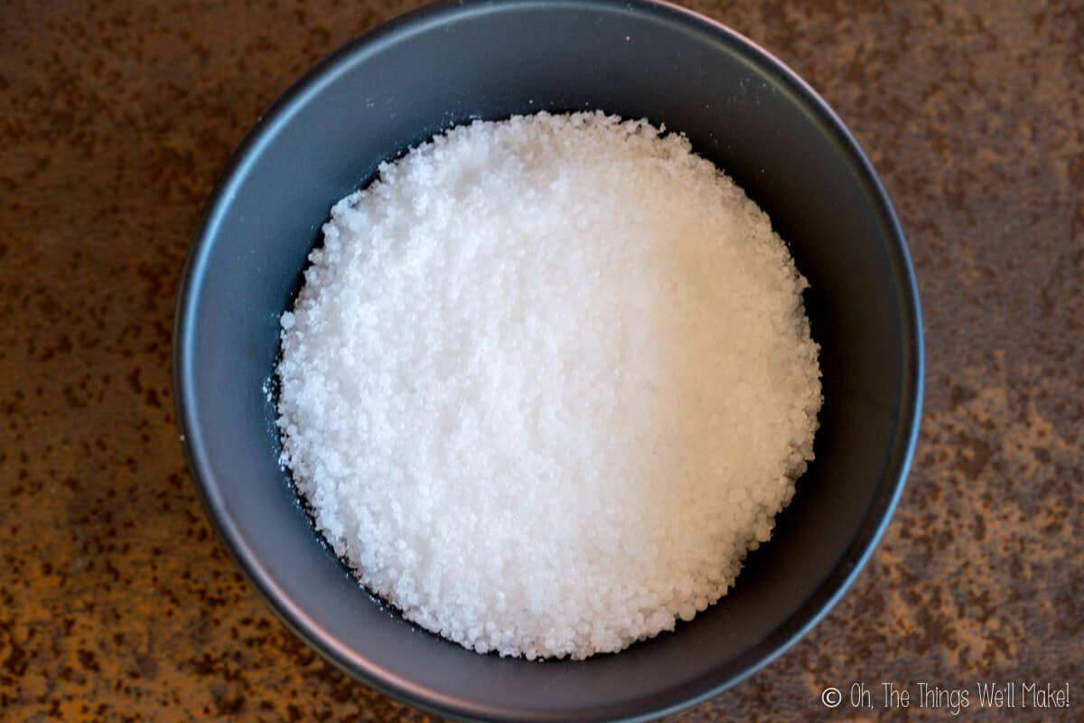 Sodium hydroxide beads in a bowl.