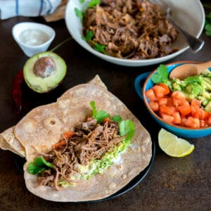 Homemade Chipotle Shredded Beef Tacos in flour tortillas.