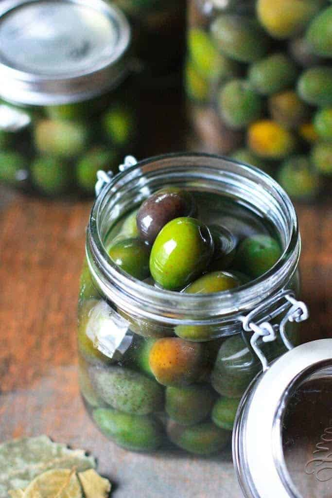 A jar filled with lye-cured olives
