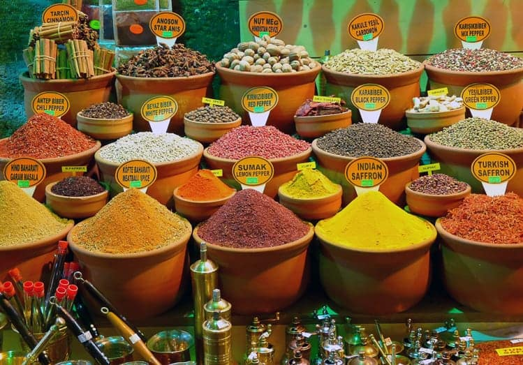 spices in clay containers in a street market