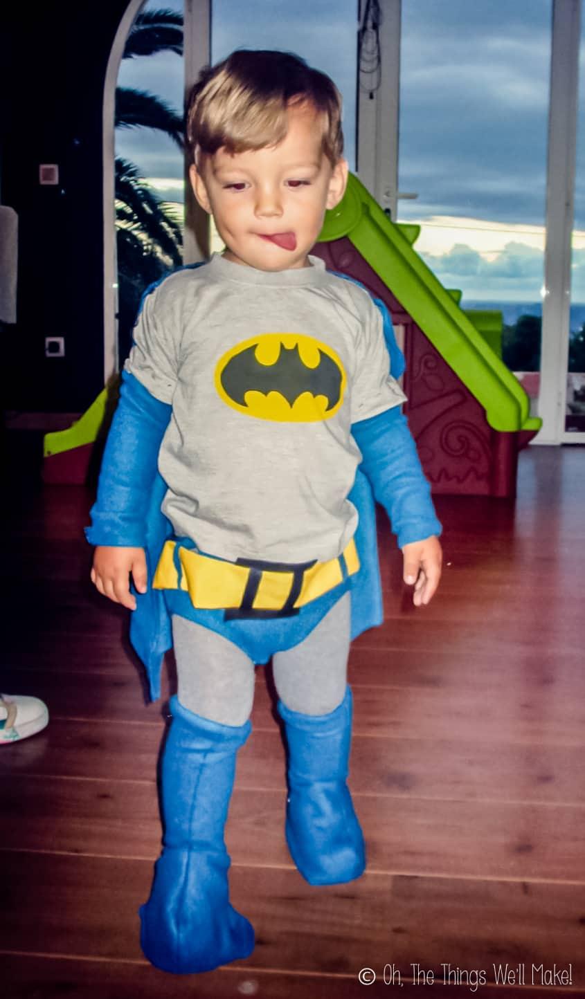 A boy wearing a homemade Batman costume