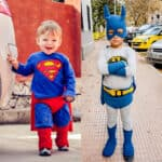 A young boy in a Superman costume and a boy in a Batman costume