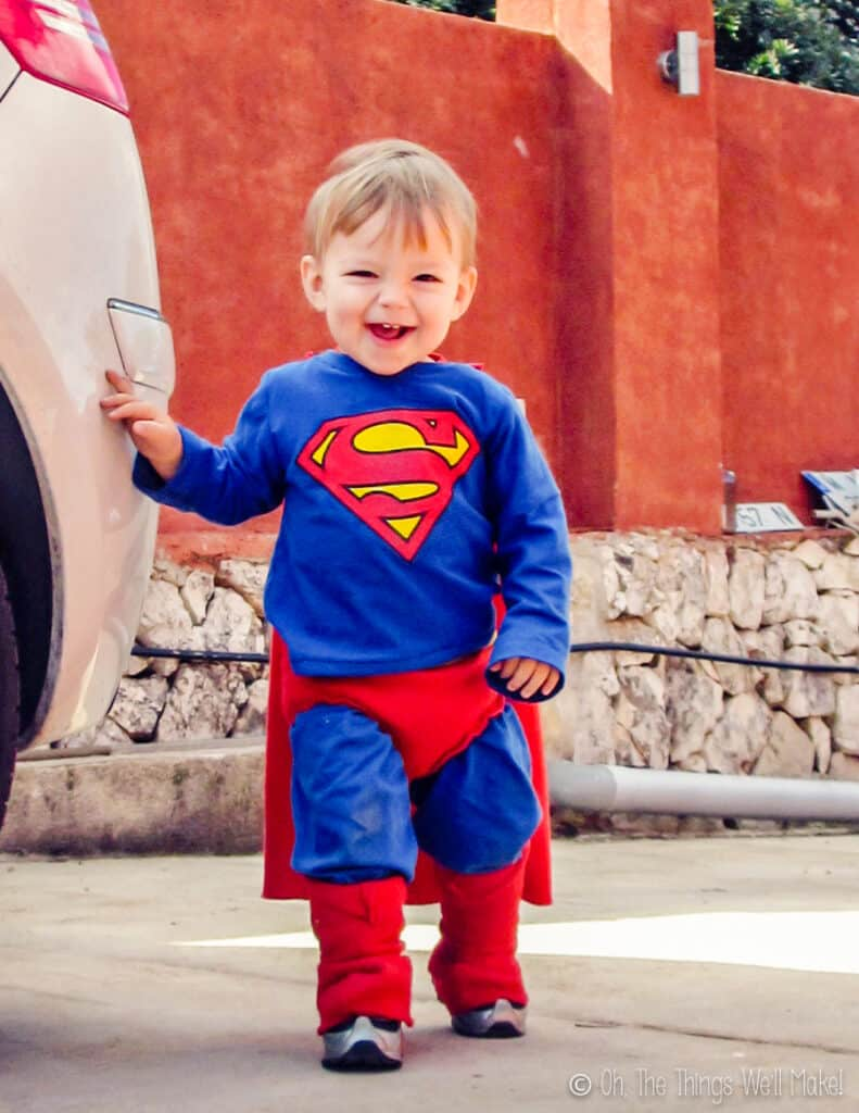 A young boy wearing a homemade superman costume